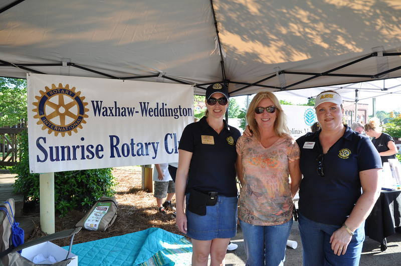 Waxhaw Rotary President Elect Cathy Burns of Allen Tate Realty, Nancy McCoy Duncan and friend