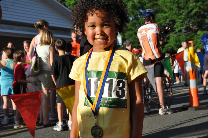 Amanda Thompson,5, of Waxhaw shows off her medal