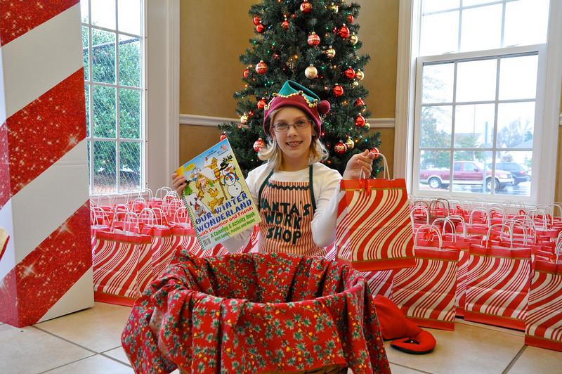 Lizzie Watson, 11 yrs. old Santa's helper