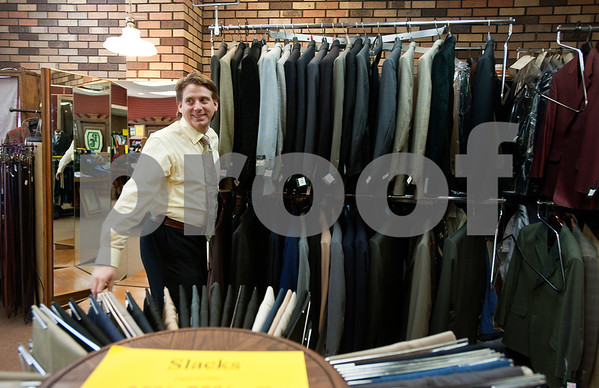 copyright 2012 Sarah A. Miller/Tyler Morning Telegraph  Penick & Chance owner John Chance pulls out a rack of suit coats inside the men's clothing store located in the Olde English Village shopping center in Tyler. The store is closing their doors after 46 years.