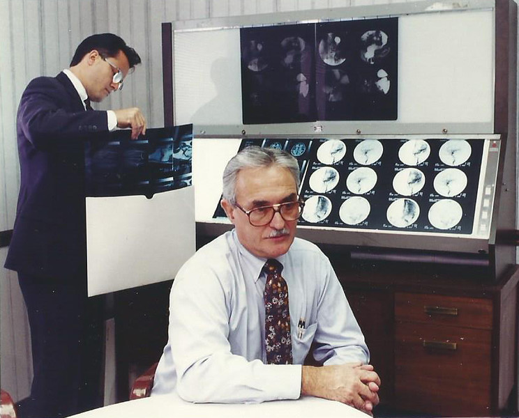 . 1994: Albert D. Perrico, president of Alpha Imaging Inc. in Willoughby, is shown in front of some X-rays that are produced by the medical imaging devices that the company distributes. In the background is his son Michael Perrico, an account executive for the company. Alpha Imaging was the No.23  Established company on the Fast Track 50 in 1993, the inaugural year for the event. News-Herald file