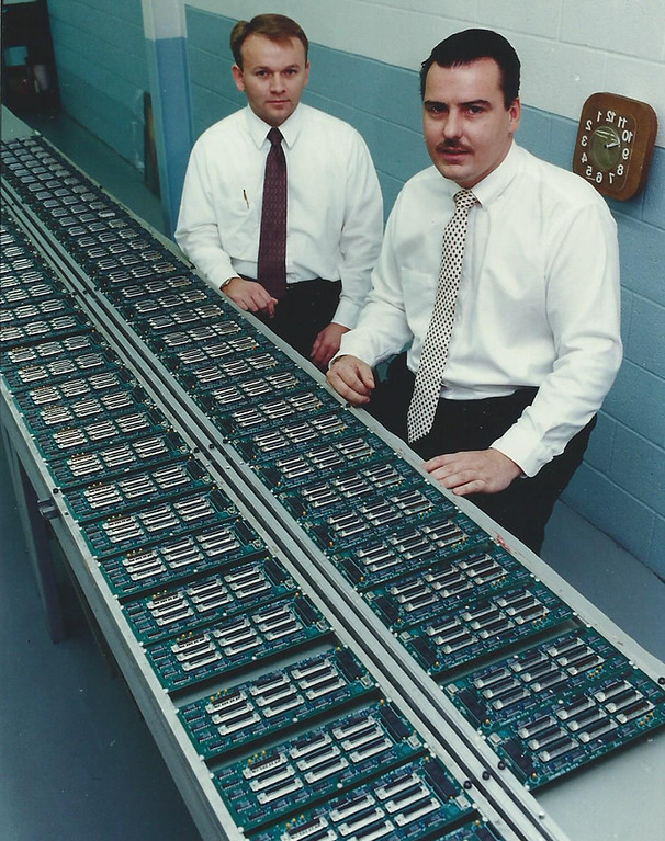 . 1993: Sanford Burris, president, left, and Bill Cooper of Sabtronix show a sample of the circuit boards made by the company. Based in Willoughby, Sabtronix was the No. 10 Emerging company on the Fast Track 50 in 1993, the inaugural year for the event. News-Herald file