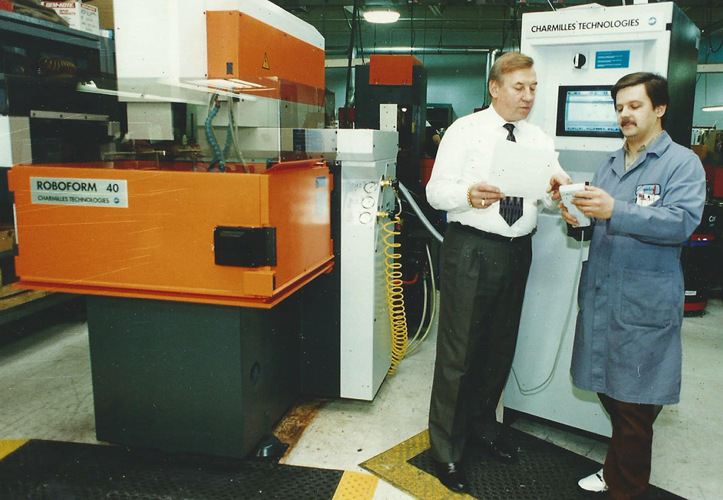 . 1994: Frank Chicon, left, president of Mold Masters International Inc. of Mentor, talks with John Grabianowski, a mold master, in their Mentor plant. Mold Masters International was the No. 18 Established company on the Fast Track 50 in 1993,  the inaugural year for the event. News-Herald file