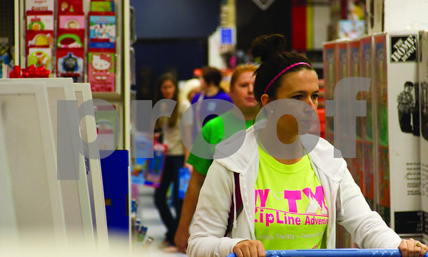 Shoppers at Toys R Us look for the best prices on holiday gifts.