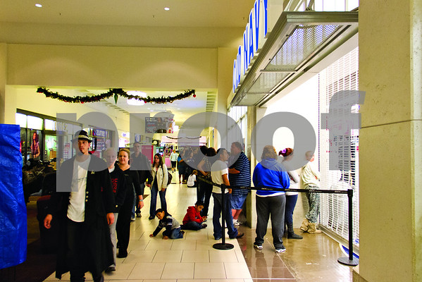 At 10:00 in the eveing on Thanksgiving lines begin to form outside of Old Navy in the Broadway Square Mall for their opening at midnight.