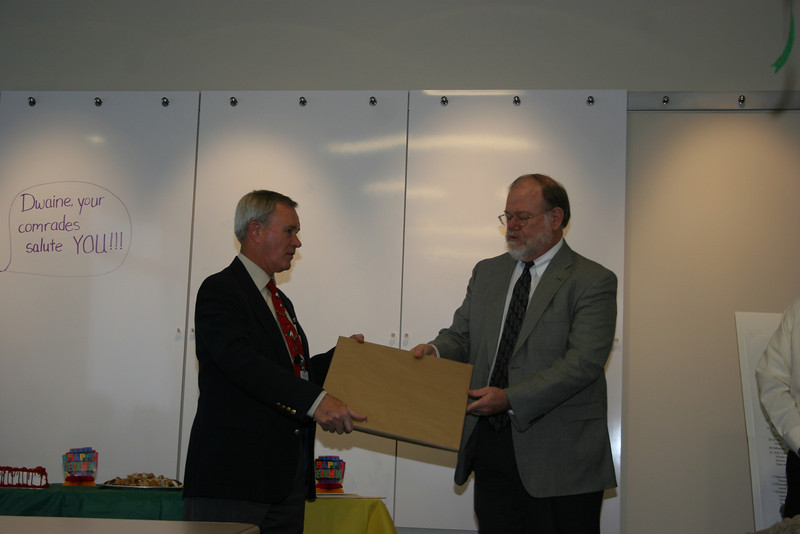 Dwaine receiving retirement gift from Jack