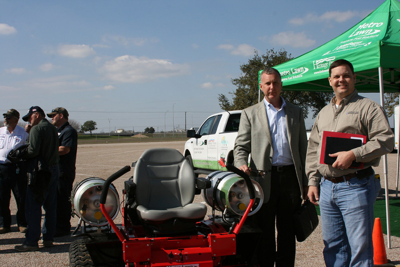 TPGA Executive Director, Bill Van Hoy and TPGA President, Chad Gray check out the propane powered commercial mowers at the Moving Texans with Propane event on February 7th in Temple .