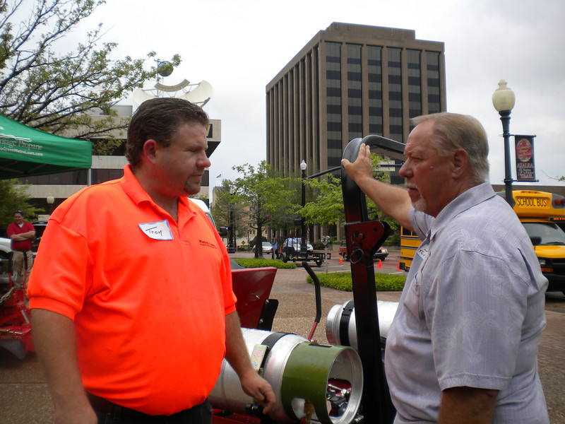 Troy Hicks, Heritage Propane and Jim Lawton, Ferris Industries showcase propane-powered commercial mowers at the Moving Texans with Propane event in Tyler, TX on March 29, 2012.