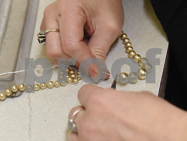 Ginger Graf of Graf's Antiques and Jewelry strings a pear necklace at her store in downtown Gladewater Friday Feb. 10, 2017.  (Sarah A. Miller/Tyler Morning Telegraph)