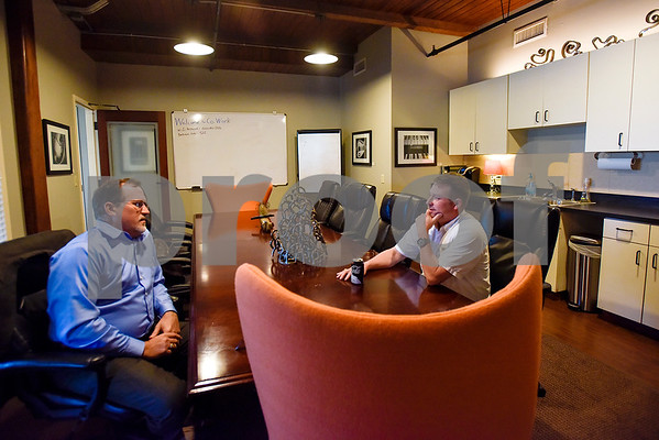 Kenny Cargill and Joe McDaniel chat in the conference room at Co.Work in Tyler, Texas, on Tuesday, March 21, 2017. Co.Work is a rent-a-desk and collaborate space for professionals who don't want the structure or expense of a full office. (Chelsea Purgahn/Tyler Morning Telegraph)