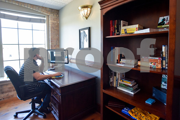 Lewis Swann of Sight.org works at Co.Work in Tyler, Texas, on Tuesday, March 21, 2017. Co.Work is a rent-a-desk and collaborate space for professionals who don't want the structure or expense of a full office. (Chelsea Purgahn/Tyler Morning Telegraph)