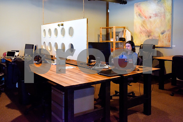 Josh Jarvis works at Co.Work in Tyler, Texas, on Tuesday, March 21, 2017. Co.Work is a rent-a-desk and collaborate space for professionals who don't want the structure or expense of a full office. (Chelsea Purgahn/Tyler Morning Telegraph)