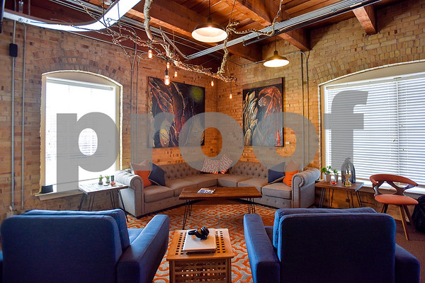 Lounge and work area at Co.Work in Tyler, Texas, on Tuesday, March 21, 2017. Co.Work is a rent-a-desk and collaborate space for professionals who don't want the structure or expense of a full office. (Chelsea Purgahn/Tyler Morning Telegraph)
