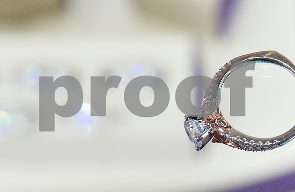 Color mixing metals is a popular trend such as this rose gold engagement ring seen Thursday at Blue The House of Jewelry. The business is now open at the Sonoma Village shopping center in Tyler.  (Sarah A. Miller/Tyler Morning Telegraph)