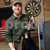 photo by Sarah A. Miller/Tyler Morning Telegraph<br /> <br /> Stone Range Gunsmith owner Mark Covey holds a Tommy Gun that needs the barrel replaced Wednesday March 25, 2015 at the shop's new location at 11726 Highway 64 East in Tyler.