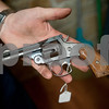 photo by Sarah A. Miller/Tyler Morning Telegraph<br /> <br /> Stone Range Gunsmith owner Mark Covey holds a Smith and Wesson model two from the 1800s that he will repair Wednesday March 25, 2015 at the shop's new location at 11726 Hwy 64 East in Tyler.