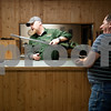 photo by Sarah A. Miller/Tyler Morning Telegraph<br /> <br /> Stone Range Gunsmith owner Mark Covey, left, and client Kenny Titman of Hawkins look at the muzzle break of a gun Wednesday March 25, 2015 at the shop's new location at 11726 Hwy 64 East in Tyler.