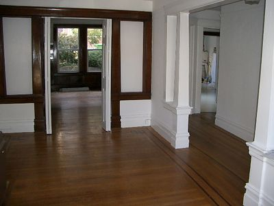 The folding doors and the panels can be removed  to make it one large room, or they can be closed to make another bed room or seperate study.  There is another entrance to this room from the hall