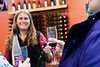 Kim Wallace from Putney Mountain Winery looks on while visitors taste the Vermont Cassis liqueur; KELLY FLETCHER, REFORMER CORRESPONDENT