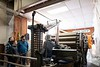 Scott Matthews explains some of the machinery at Green Mountain Spinnery to Bryan, Bronwyn and Madeleine Louisell of Brattleboro; KELLY FLETCHER, REFORMER CORRESPONDENT