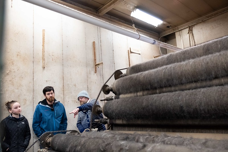 Scott Matthews explains some of the machinery at Green Mountain Spinnery to Bryan and Madeleine Louisell of Brattleboro; KELLY FLETCHER, REFORMER CORRESPONDENT