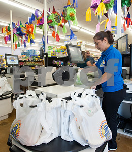 Cashier Erika Morena bags groceries at Supermercado Del Pueblo Thursday April 30, 2015. The new grocery store is located at 2311 W. Erwin St. in Tyler.  (photo by Sarah A. Miller/Tyler Morning Telegraph)