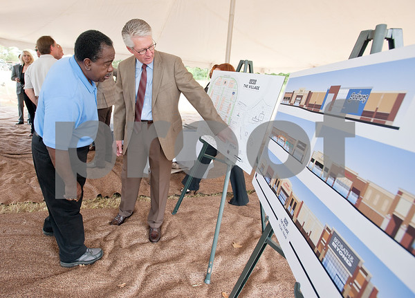 photo by Sarah A. Miller/Tyler Morning Telegraph  Seller Bob Garrett shows development plans  of the Village at Cumberland Park to Tyler city councilman Ed Moore during a groundbreaking ceremony in Tyler Tuesday. The new 750,000 square foot shopping center will offer more than 90 retailers and will create 2,000 new jobs. Many tenants will be new to Tyler, but the Village at Cumberland Park will also include some relocations of current stores and second locations for some stores.