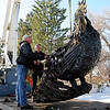 "Robert Bellows, right, talks to Larry Mitchell, the crane operator, about where to move the metal rooster he made.<br /> Robert Bellows has spend 11-months working on a sculpture of a rooster,  made from farm implements, that will be placed outside Alfalfa's Market in Boulder.<br /> For more photos of the rooster and a video, go to  <a href=""http://www.dailycamera.com"">http://www.dailycamera.com</a>.<br /> December 9, 2011 / Cliff Grassmick"