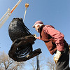 "Robert Bellows looks under the 5,000-lbs metal rooster he made. as it is loaded on the truck.<br /> Robert Bellows has spend 11-months working on a sculpture of a rooster,  made from farm implements, that will be placed outside Alfalfa's Market in Boulder.<br /> For more photos of the rooster and a video, go to  <a href=""http://www.dailycamera.com"">http://www.dailycamera.com</a>.<br /> December 9, 2011 / Cliff Grassmick"