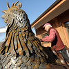 "Robert Bellows looks for the connection on his rooster for the crane to connect.<br /> Robert Bellows has spend 11-months working on a sculpture of a rooster,  made from farm implements, that will be placed outside Alfalfa's Market in Boulder.<br /> For more photos of the rooster and a video, go to  <a href=""http://www.dailycamera.com"">http://www.dailycamera.com</a>.<br /> December 9, 2011 / Cliff Grassmick"