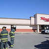 A blue Hyundai was driven through the window of Wyman's Liquors on Electric Ave. in Fitchburg Wednesday afternoon. Firefighters can be seen just outside the store planning their next move. SENTINEL & ENTERPRISE/JOHN LOVE