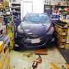 A blue Hyundai was driven through the window of Wyman's Liquors on Electric Ave. in Fitchburg Wednesday afternoon. The car came to a stop in this isle in the store. SENTINEL & ENTERPRISE/JOHN LOVE