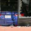 A blue Hyundai was driven through the window of Wyman's Liquors on Electric Ave. in Fitchburg Wednesday afternoon. SENTINEL & ENTERPRISE/JOHN LOVE