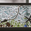 """""""Gone Fishing"""" stained glass by Vera Clauson, at the Artisans Exchange in Central Square, Chelmsford.  (SUN/Julia Malakie)"""