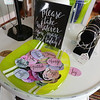 The encouraging words from July Design are free. Bracelets at right by Sara Hesselton, one of the co-owners of the Artisans Exchange in Central Square, Chelmsford.  (SUN/Julia Malakie)