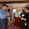 Woodworker John Santoro of Billerica, one of the artisans whose work is for sale there, talks with Carissa Campbell of Chelmsford, one of the co-owners of the Artisans Exchange in Central Square, Chelmsford.  (SUN/Julia Malakie)