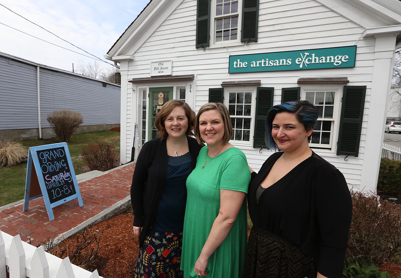 From left, Sara Hesselton, Eileen DeChaves, all of Chelmsford, and Carissa Campbell, all of Chelmsford, co-owners of the Artisans Exchange in Central Square, Chelmsford.  (SUN/Julia Malakie)