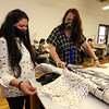 Assemble Lab production manager Sharon Drelick of Windham, N.H., left, and Karen Blumsack of Amesbury, who does product development, pull out some silks which they plan on using for summer masks, to be lighter weight, at the company's space at Western Ave Studios, where they have switched from fashion orders to making masks for the COVID-19 pandemic. (SUN/Julia Malakie)