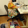 Assemble Lab sample maker Amanda Olsen of Georgetown does finish work, attaching elastics on masks, at the company's space at Western Ave Studios, where they have switched from fashion orders to making masks for the COVID-19 pandemic. (SUN/Julia Malakie)