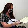 Assemble Lab's Karen Blumsack of Amesbury, who does product development, with her design sketchbook, and a mask pattern cutout, at the company's space at Western Ave Studios, where they have switched from fashion orders to making masks for the COVID-19 pandemic. (SUN/Julia Malakie)