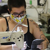 Assemble Lab sample maker Jessica Soter of Woburn does topstitching, one of the last steps on masks, at the company's space at Western Ave Studios, where they have switched from fashion orders to making masks for the COVID-19 pandemic. (SUN/Julia Malakie)
