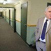 Standing in the hallway of the 10th floor of the Sunset Towers in Leominster Executive Director Gene Capoccia of the housing authority talks about new program to keep the elderly in their homes. The Leominster housing authority has dedicated the 10th floor of the Sunset Towers at 100 Main Street in Leominster to assisted living in a revolutionary idea that could be a model for the state. Leominster Housing Authority and Director Capoccia are expanding an assisted living program at Sunset Towers on Main Street that allows residents to remain in their community rather than going to a more traditional and expensive facility when living on their own becomes more challenging. SENTINEL & ENTERPRISE/JOHN LOVE