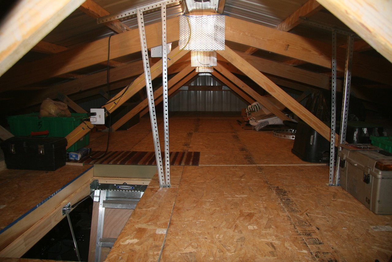 Attic space being cooled.  This is an inferno during the Summer.  The ridge vent system brings the temperature  down to 90-100F depending on outside air temperature.  Cold air can be brought through the step access opening if required.  The shop space is evaporatively cooled.