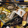 Kayla Rice/Reformer<br /> A pile of small antique trinkets on the counter at Aumand's Junk-Tiques in Bellows Falls.