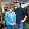 "Kayla Rice/Reformer<br /> Lori and Bill Aumand stand in their newly opened antiques store ""Aumand's Junk-Tiques"" in Bellows Falls."