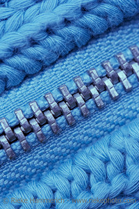 Macro of Closed Zipper on Sweater - Detail of Knitting Pattern