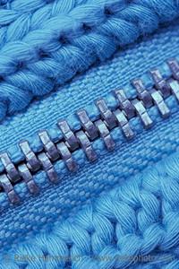 Macro of Closed Zipper on Sweater - Detail of Knitting Pattern