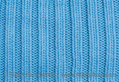 Close-up of a woolen pattern - knitting pattern with purls and knits - adobe RGB