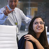 Social media intern Inbar Porat of Westforo shows a tattoo of a bird inspired by her favorite poem, done with Brilliant INQUE. At rear is Dr. Satish Agrawal, CEO of Bambu Vault and CTO of the Bambu companies. (SUN/Julia Malakie)