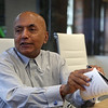 """Satish Agrawal, CEO of Bambu Vault and CTO of the Bambu companies, explains INQUE's new tattoo technoloy with which tattoos can be """"blanqued"""" to make them invisible. He was explaining how something (molecules?) fold up to make the color invisible. (SUN/Julia Malakie)"""